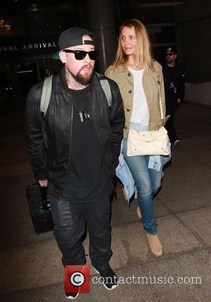 cameron diaz - Benji Madden and Cameron Diaz at Los Angeles International Airport (LAX) - Los Angeles, California, United States...
