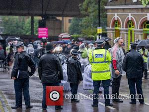 Atmosphere , View - Police officers enjoy a hot drink and take shelter from the rain prior to the Notting...