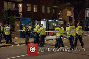 View - Police guard the scene of a stabbing on the corner of Elgin Crescent and and Ladbroke Grove in...