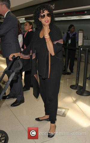 Tamera Mowry - Tamera Mowry arrives at Los Angeles International (LAX) airport - Los Angeles, California, United States - Tuesday...