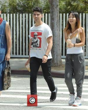 Joe Jonas - Joe Jonas shows off his karate moves while out for lunch with friends in West Hollywood. -...