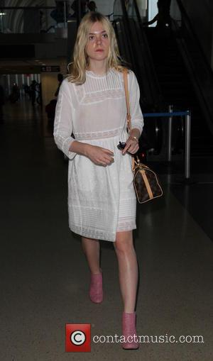 Elle Fanning - Elle Fanning arrives at Los Angeles International (LAX) airport - Los Angeles, California, United States - Wednesday...