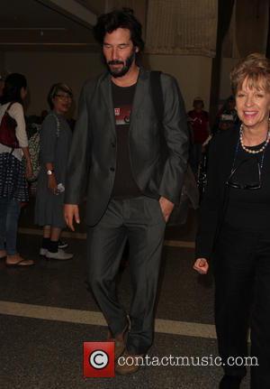 Keanu Reeves - Keanu Reeves arrives at Los Angeles International (LAX) Airport - Los Angeles, California, United States - Wednesday...