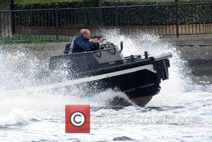 Atmosphere - Filming scenes for the new movie 'Stratton' starring Dominic Cooper and Tom Felton on the Thames in Canary...