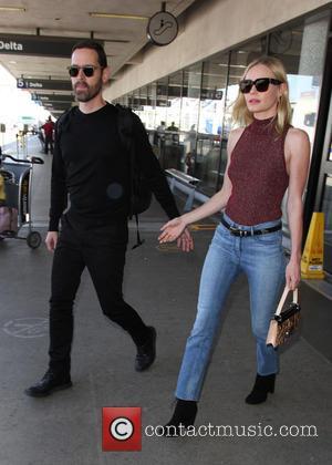 Kate Bosworth , Michael Polish - Kate Bosworth and husband Michael Polish at Los Angeles International Airport (LAX) at Los...