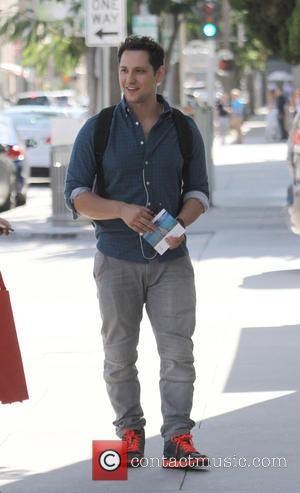 Matt McGorry - Matt McGorry stops to chat with some employees of YOGASMOGA while out in Beverly Hills at Beverly...