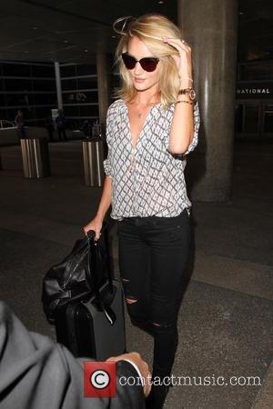 Rosie Huntington-Whiteley - Rosie Huntington-Whiteley arriving at Los Angeles International Airport (LAX) at Los Angeles International Airport (LAX) - Los...