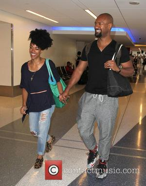 Sonequa Martin-Green , Kenric Green - Sonequa Martin-Green and husband Kenric Green at Los Angeles International Airport (LAX) at Los...