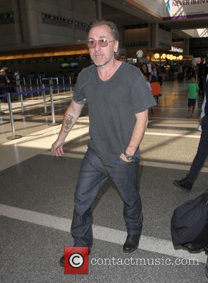 Tim Roth - Tim Roth arriving at Los Angeles International Airport (LAX) to catch a flight at Los Angeles International...