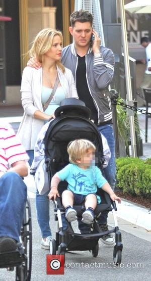 Michael Bublé, Luisana Lopilato , Noah Buble - Michael Buble chats on his mobile phone while out shopping with his...
