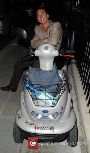 Bruno Tonioli , Jackie St Clair - Bruno Tonioli sits on an mobility scooter outside The Zetter Townhouse Hotel in...