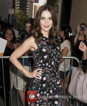 Alison Brie - Jason Sudeikis and Alison Brie Arrive to Apple Store at Apple Soho Store - New York, New...