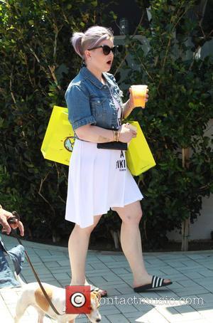 Kelly Osbourne - Kelly Osbourne goes shopping with a friend at Planet Blue in Malibu - Malibu, California, United States...