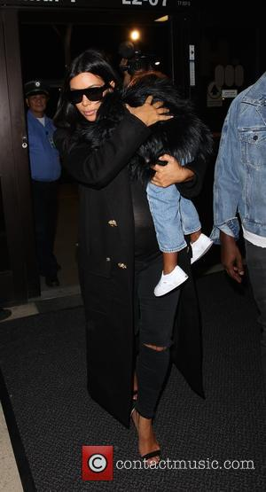 Kim Kardashian , North West - Pregnant Kim Kardashian and Kanye West arrive with their daughter North at Los Angeles...