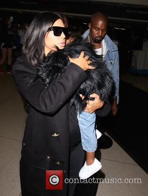 Kim Kardashian, Kanye West , North West - Pregnant Kim Kardashian and Kanye West arrive with their daughter North at...