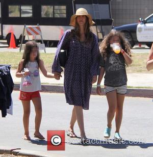 Jackie Sandler, Sadie Madison Sandler , Sunny Madeline Sandler - Adam Sandler wearing a large straw hat goes out and...