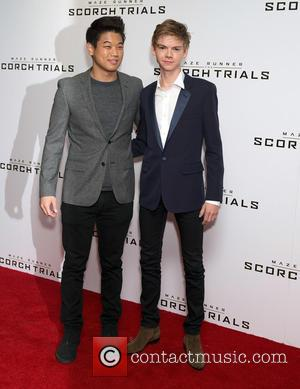 Ki Hong Lee and Thomas Brodie-sangster