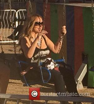 Mariah Carey , Moroccan Cannon - Mariah Carey and her son Moroccan at the Malibu Fair - Malibu, California, United...