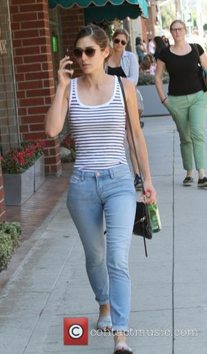 Lizzy Caplan - Mean Girls star, Lizzy Caplan talking on her cellphone as she goes shopping in Beverly Hills -...