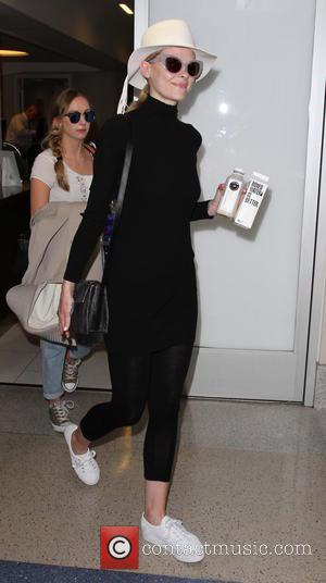 Jaime King - Jaime King departs from Los Angeles International Airport (LAX) carries a carton of water dressed in black...
