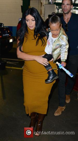 Kim Kardashian , North West - Pregnant Kim Kardashian and daughter North West running errands in New York City. North...