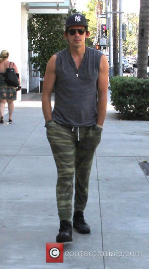 Lukas Haas - Lukas Haas dressed in army fatigues out and about in Beverly Hills walking with his hands in...