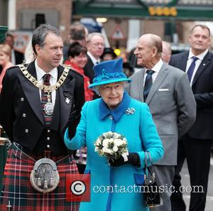 The Rt. Hon. Donald Wilson, Queen Elizabeth II , The Duke of Edinburgh - It was the day on which...