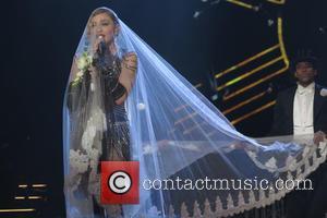 Madonna Suffers Wardrobe Malfunction At Thailand Show