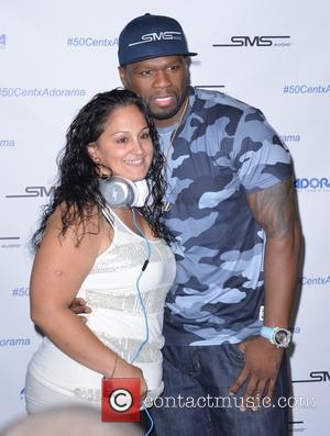 50 Cent , Curtis James Jackson III - 50 Cent signs his Studio Mastered Sound Headphones by Curtis '50 Cent'...