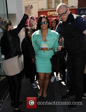 Demi Lovato - Demi Lovato leaves Capital Radio surrounded by fans. - London, United Kingdom - Thursday 10th September 2015