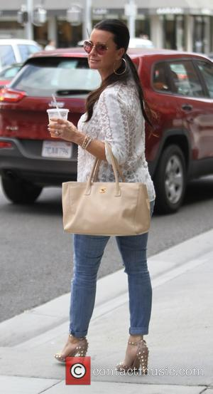 Kyle Richards - Kyle Richards has lunch with a friend at Comoncy cafe in Beverly Hills - Los Angeles, California,...