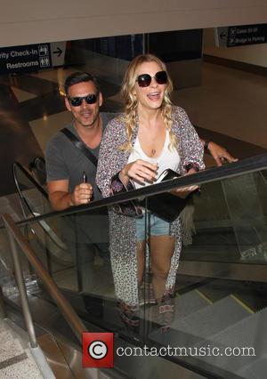 LeAnn Rimes , Eddie Cibrian - LeAnn Rimes departs from Los Angeles International Airport (LAX) with her husband Eddie Cibrian...