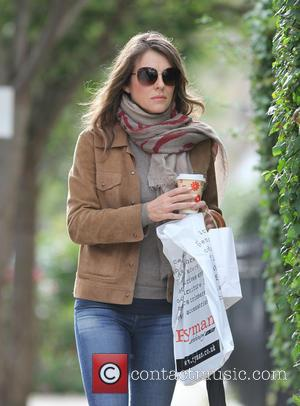 Elizabeth Hurley - Elizabeth Hurley returns home carrying a cup of coffee after shopping at Ryman in London at chelsea...