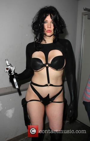 Maitland Ward - Maitland Ward gets some help changing costumes from Slave Leia to Aeon Flux at Long Beach Comic...
