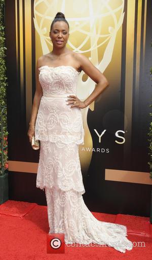 Aisha Tyler - 2015 Creative Arts Emmy Awards at Microsoft Theater - Arrivals at Emmy Awards - Los Angeles, California,...
