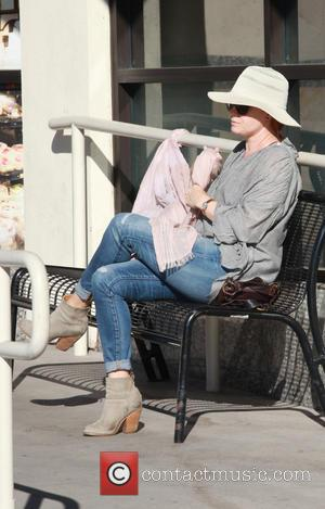 Amy Adams - Amy Adams has her hands full carrying daughter Aviana and giving her a cuddle while shopping at...