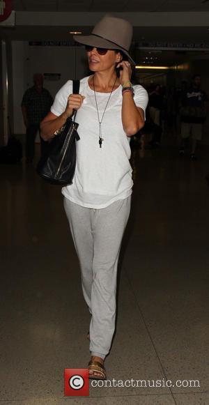 Brooke Burke-Charvet - Brooke Burke-Charvet arrives at Los Angeles International Airport (LAX) - Los Angeles, California, United States - Monday...