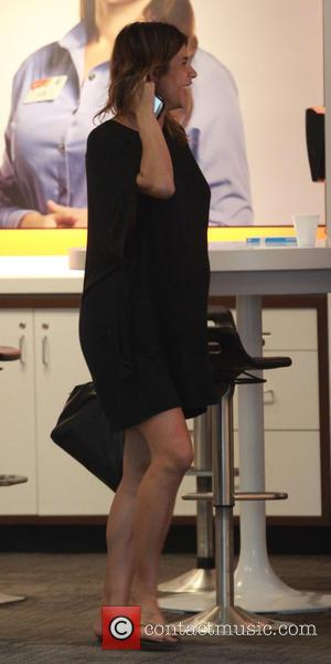 Elisabetta Canalis - Elisabetta Canalis buying a new Phone at ATT store in West Hollywood where she took her first...