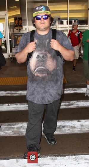Jack Black - Jack Black arrives at Los Angeles International Airport (LAX) sporting a large dog head t-shirt - Los...