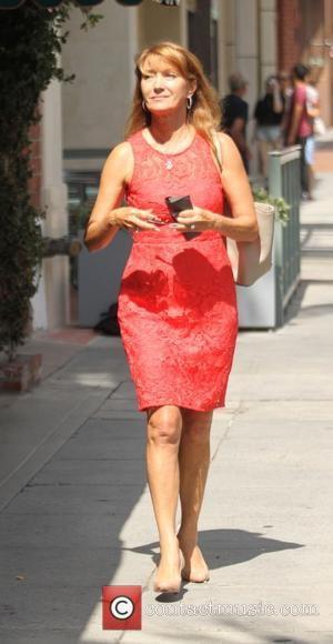 Jane Seymour - Jane Seymour leaves an office in Beverly Hills in a summer red dress - Los Angeles, California,...