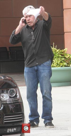 Ron Perlman - Ron Perlman busy talking on his cell phone as leaves  an office in Beverly Hills -...