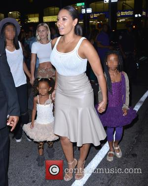 Mel B, Phoenix Chi Gulzar, Madison Brown Belafonte , Angel Iris Murphy Brown - Mel B and her family outside...