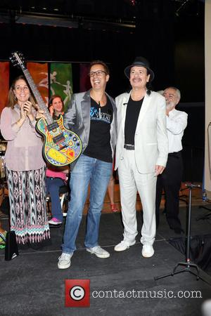 Carlos Santana - Legendary guitarist Carlos Santana donates instruments to Opportunity Village's Music Program held at Opportunity Village Campus -...
