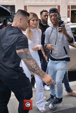 Kylie Jenner - Kylie Jenner, closely followed by boyfriend Tyga, arrives at their hotel - Manhattan, New York, United States...