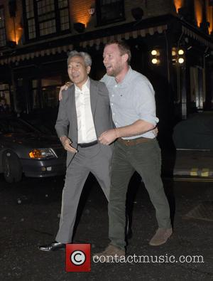 Guy Ritchie - Guy Ritchie in a playful mood, hugging a friend when leaving Chiltern Firehouse - London, United Kingdom...