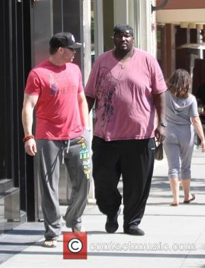 Quinton Aaron - Quinton Aaron, the star of the Oscar-nominated film The Blind Side, goes shopping in Beverly Hills in...