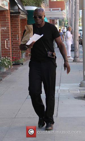 Seal - Seal out and about running errands in Beverly Hills dressed all in black and carrying his compact camera...
