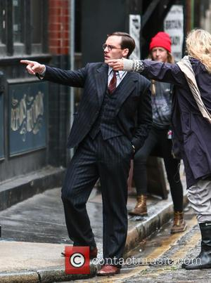 Sam Claflin - Gemma Arterton films a scene for the movie 'Their Finest Hour and a Half' in east London...