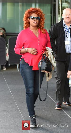 Kelis - Kelis signs autographs and poses for pictures with fans as she leaves the BBC Breakfast studios in Manchester....