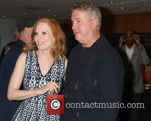 Marg Helgenberger and William Petersen